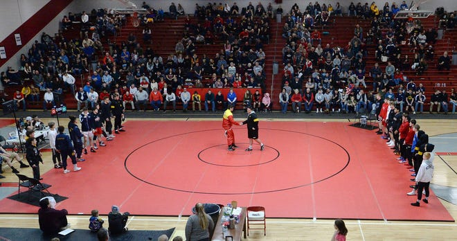 Wrestlers, including Girard's Jordan Schell, center left, with North Allegheny's Ben Grafton, are introduced prior to the finals of the Tool City Tournament at Meadville Area Senior High School in Meadville on Jan. 4, 2020.