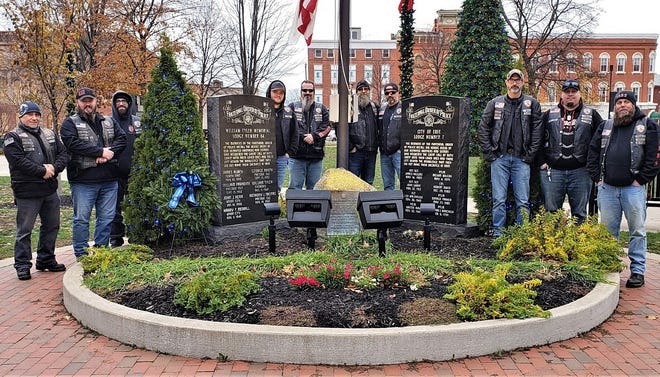 Members of the Erie County chapter of the Enforcers Motorcycle Club honored area law enforcement officers who died in the line of duty by placing wreaths on the graves of 18 fallen officers and at police memorials in Erie's Perry Square and at Pennsylvania State Police Troop E headquarters in Lawrence Park Township on Saturday.
