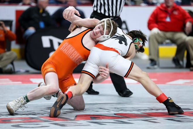 Cathedral Prep's Jake Van Dee, left, wrestles Greater Latrobe's Vincent KilKeary during the 106-pound championship f during the PIAA Class 3A championships March 7, 2020, at Giant Center in Hershey, Pennsylvania. KilKeary won in overtime. Van Dee is one of the top returning wrestlers in District 10.