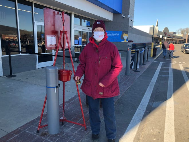 Assemblywoman Marjorie Byrnes rings the bell for the Salvation Army Red Kettle campaign in front of the Hornell Walmart store on Tuesday. The Hornell Salvation Army needs additional bell ringers. Call 607-324-1933 or 939-349-1583 to schedule a bell ringing shift.