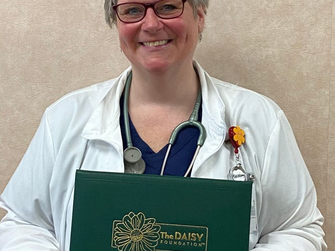 Patricia Derowitsch RN, BSN, Director of Noyes' Acute Care, Nursing Education and Community Outreach programs, with the DAISY Nurse Leader Award.
