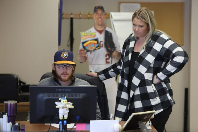 Burlington Bees general manager Kim Parker works with Nick Carey, sales, community relations and stadium operations executive, in the Bee's offices Jan. 24, 2020, at Community Field.