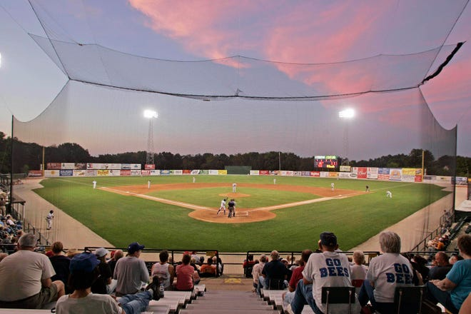 A Burlington Bees batter comes to the plate against the Clinton LumberKings as the sun sets on the game at Community Field in Burlington. On Wednesday, Kim Parker got the news Burlington was not one of the 120 teams that were invited to receive a Player Development License from Major League Baseball for the 2021 season.