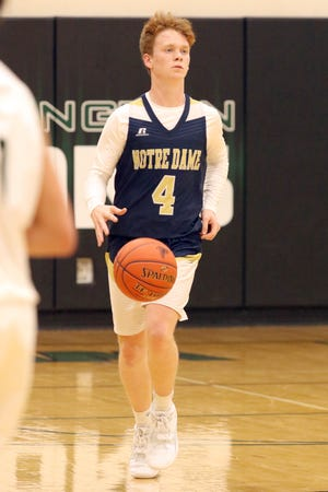 Notre Dame Nike's Sam Brueck brings the ball down court during a game against West Burlington Tuesday in West Burlington.