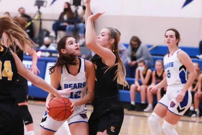 Danville High School freshman Gracianna Walker goes up for a shot while guarded by Central Lee's Macy Watkins Tuesday at Danville.
