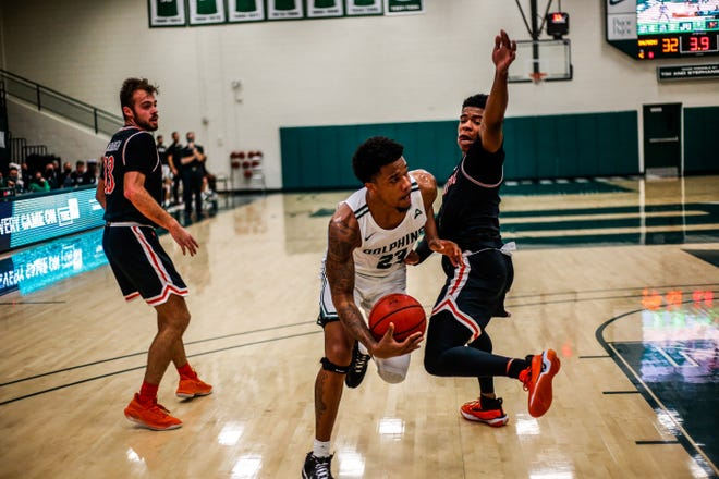 Jacksonville University's Tyreese Davis drives on a Campbell player during Tuesday's game at Swisher Gym.