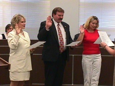 Linda Ashby swore in Julie Starr as mayor, Charley Ellis, Jr. as councilmember, and Nancy Kirkpatrick as councilmember in 2003.