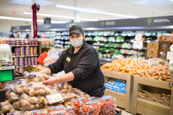 Austin Amaral, produce associate at Stop and Shop in Somerset is seen in the updated produce section.