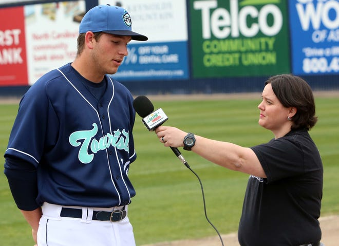 Asheville Tourists infielder Grant Lavigne, the Colorado Rockies first-round draft pick this past season, talks with a reporter during last season's Media Day at McCormick Field. [DEAN HENSLEY/ TIMES-NEWS]