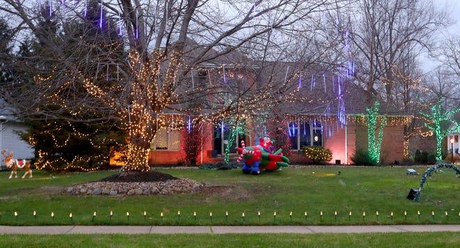 Holiday lights at 809 Bentley Place Blvd. on Monday, Dec. 7, 2020 in Tallmadge, Ohio. [Phil Masturzo/ Beacon Journal]