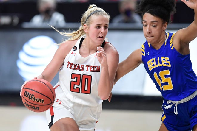 Texas Tech's Bryn Gerlich (20) drives the ball against Angelo State Wednesday, Dec. 10, 2020, in the United Supermarkets Arena in Lubbock, Texas.