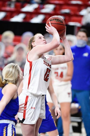 Texas Tech's Vivian Gray (12) attempts a shot against Angelo State during a nonconference game Wednesday at the United Supermarkets Arena. Gray finished with 19 points to lead the Lady Raiders to an 87-46 win.