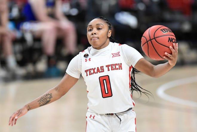 Texas Tech's Chrislyn Carr (0) controls the ball against Angelo State Wednesday, Dec. 10, 2020, in the United Supermarkets Arena in Lubbock, Texas.