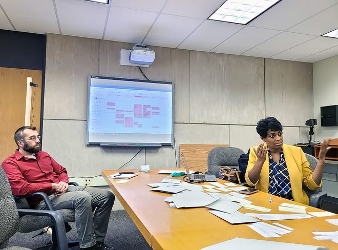 Corning Inc. executive Dawn White, right, who led collaborative efforts to develop the outline for police reform plans in Steuben County, gestures during a meeting.