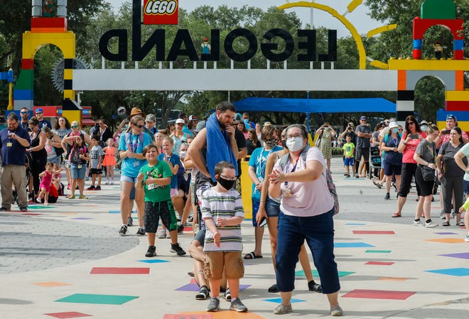 Guests enjoy the music as they wait  to enter Legoland Florida in Winter Haven in June. A report by Destinations Florida this week found a slight uptick in people planning to make Florida trips but also said a tourism recovery is at least a year away.