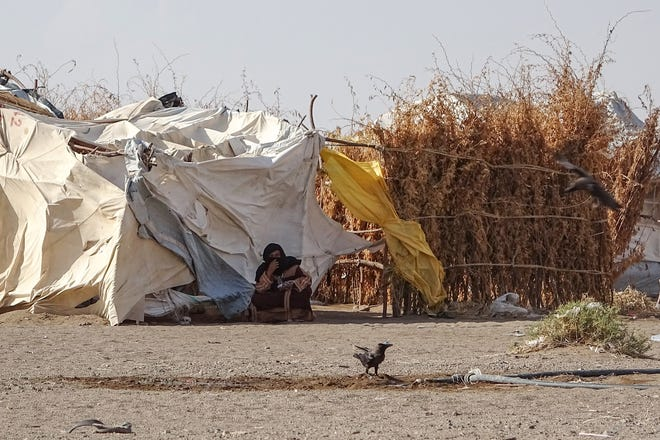 A woman sits outside a tent at a displaced persons camp in the Khokha district of Yemen's western province of Hodeida, on May 6, 2020. (Khaled Ziad/AFP via Getty Images/TNS)