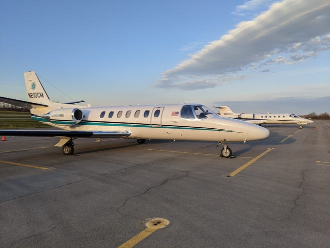 Two jets involved in transporting a heart and other vital organs from a local donor to the New York City  area are seen on the morning of Nov. 20, 2020, at the Canandaigua Airport. The jets are waiting for surgical teams to return to the airport.