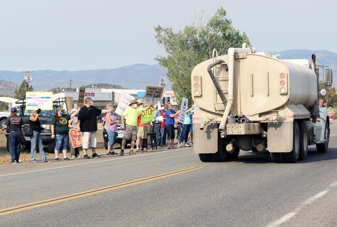 A water truck makes its way between lines of protesters on A-12 in Montague on Aug. 22, 2020, where neighbors picketed against the pumping and selling of local water to irrigate illegal marijuana grows in Siskiyou County.