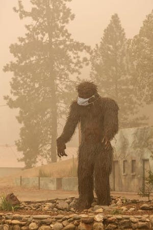 Happy Camp's protector Bigfoot stands sentry to  the town amidst a think blanket of smoke. Much of the town was destroyed by the Slater Fire on Sept. 8, 2020.