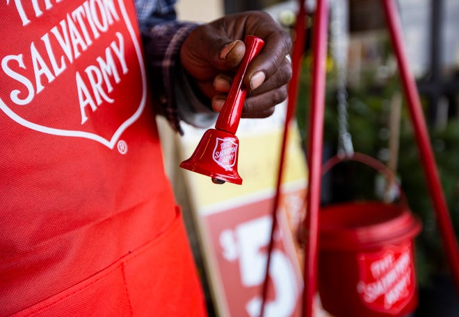 Salvation Army bell ringer Ivory Carter Sr. rings a bell to raise funds for The Salvation Army outside the Market Street store on 42nd St. in Odessa, Texas. [Jacob Ford/Odessa American via AP, File Photo]
