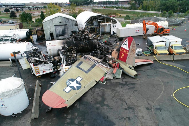 This photo, provided by the National Transportation Safety Board, shows damage from a World War II-era B-17 bomber plane that crashed on Oct. 2, 2019, at Bradley International Airport in Windsor Locks, Conn. [NTSB via AP]