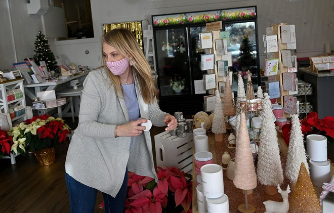 Lisa Churchill, owner of Blush Bouquets, puts gifts out for display in her Ashland shop on Wednesday, Dec. 9, 2020. Churchill specializes in selling products from local female-owned small businesses.