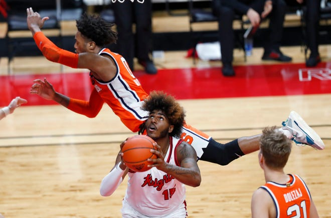 Rutgers center Myles Johnson (15) is fouled by Syracuse forward Alan Griffin (0) during the second half Tuesday in Piscataway, N.J.