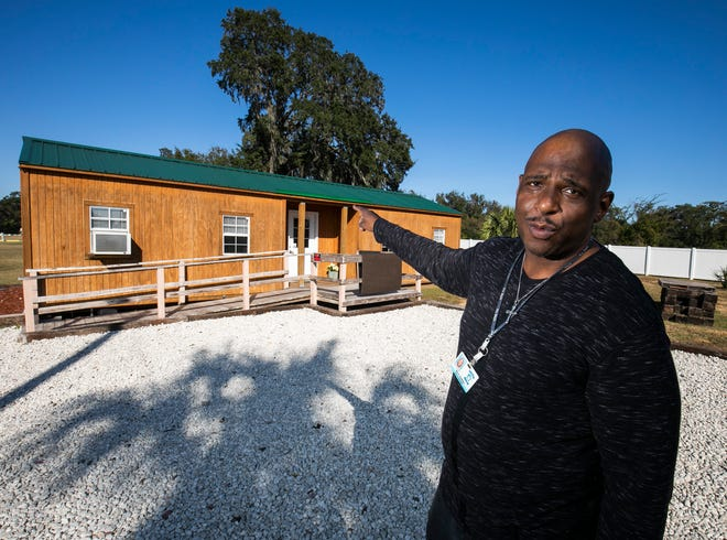 Mark Lindsay, general manager of Saving Mercy, shows off a tiny apartment home on Wednesday. The tiny homes make up part of the planned development for the homeless transition facility at 3601 W. Silver Springs Blvd. in Ocala.