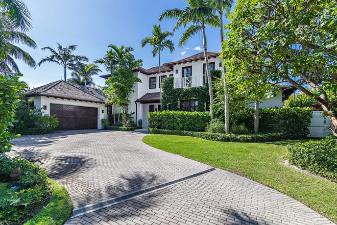 Recently sold for a reorded $7.3 million, a Palm Beach house at 245 Ridgeview Drive was built as a custom home by the sellers. The buyer just put the house back on the market for $8.2 million.