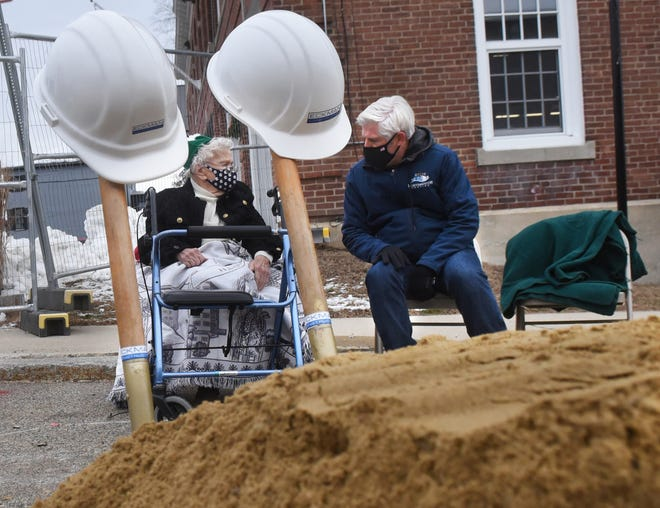 Former longtime Portsmouth Housing Authority board member Ruth Griffin speaks with PHA Executive Director Craig Welch prior to the official groundbreaking of a 64-unit affordable housing apartment building on Court Street Wednesday.