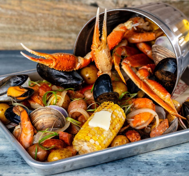 A Cajun seafood boil at Lucky Shuck, one of the three restaurant concepts at the new Love Street complex.  [Photo by LibbyVision.com]