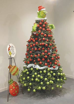 A Christmas tree decorated like a Grinch is part of this year's annual Vernon Filley Museum Festival of Trees, Wreaths and Holiday Decorations Show in Pratt. The show is viewable online or in person.