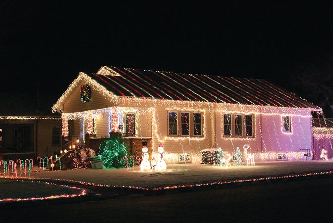 Zach Shanline and his family at the southwest corner of Fifth and High streets in Pratt have created a Christmas holiday masterpiece (above) with thousands of lights covering their home and yard.