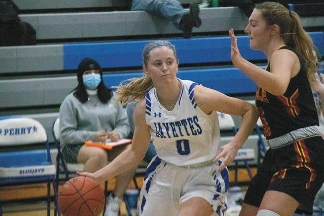 Lydia Olejniczak looks to move around a Carlisle player on Tuesday, Dec. 8.