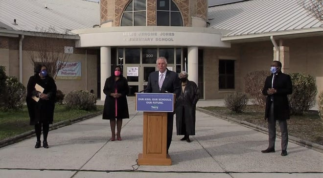 Former Virginia Gov. Terry McAuliffe speaks at a ceremony announcing his candidacy for the Democratic gubernatorial nomination at Miles Jones Elementary School in Richmond. Va., Wednesday, Dec. 8, 2020.