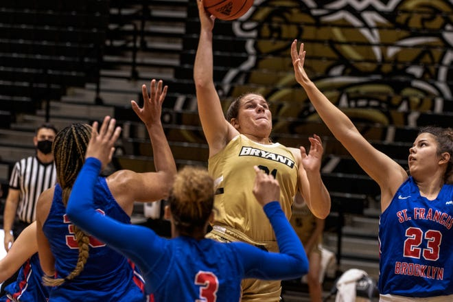Bryant's Nicole Gallagher takes one up in the lane during the Bulldogs' overtime win against St. Francis-Brooklyn Tuesday.