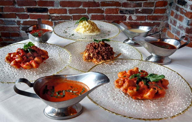 Clockwise from top fettucine with Alfredo sauce, Bolognese over fettucine, Pink Vodka sauce over Gnocchi, and Marinara over Gnocchi.  Each sauce is pointing to a dish of fresh pasta.