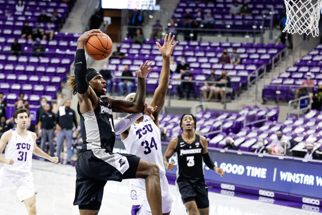 Providence Greg Gantt goes strong to the hoop against TCU's Kevin Easley Jr. in the first half Wednesday night.