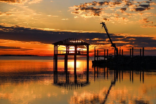 The sun sets on the pier in Port St. Joe, now under construction