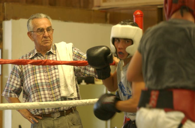 Longtime Stockton boxing trainer Frank Dobales, left, watches a sparring session in 2003. Dobales passed away from complications of COVID-19 on Tuesday. He was 91.