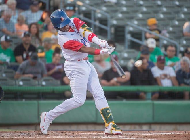 Stockton Ports' Lazaro Armenteros hits a fly ball during a California League game against the Modesto Nuts July 31, 2019, at Stockton Ballpark in downtown Stockton.