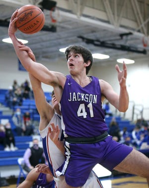 Jovan Jovicic (41) of Jackson fights for a rebound against Camden Horning (back) of Lake during their game at Lake on Tuesday, Dec. 8, 2020.