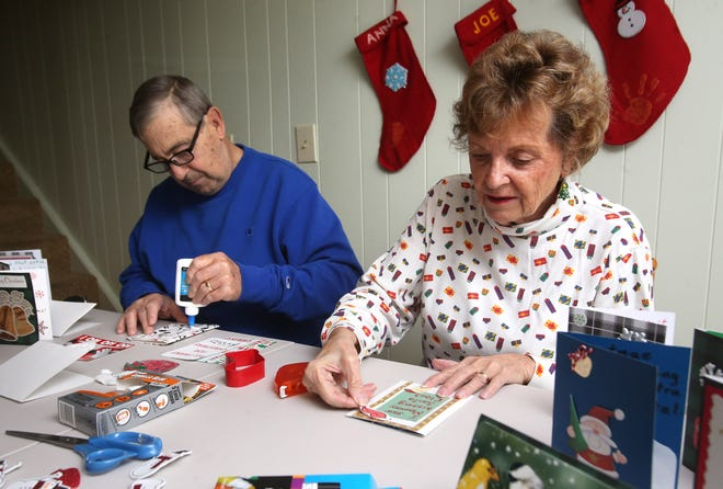 Court Angel volunteers Dan and Betty Kress, of Perry Township, make cards that will be sent to nursing facilities and other care centers. Stark County Probate Judge Dixie Park said that isolation can be harmful to the health of nursing facility residents who do not get as many visitors during the pandemic.