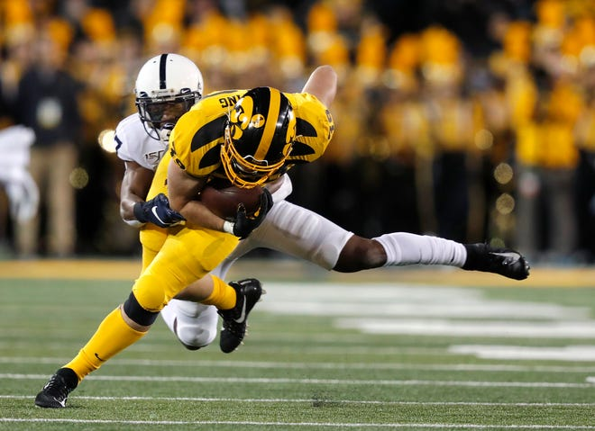 Penn State safety Garrett Taylor, left, pulls down Iowa tight end Nate Wieting, a former Lutheran standout, on Oct. 12, 2019, in Iowa City, Iowa.