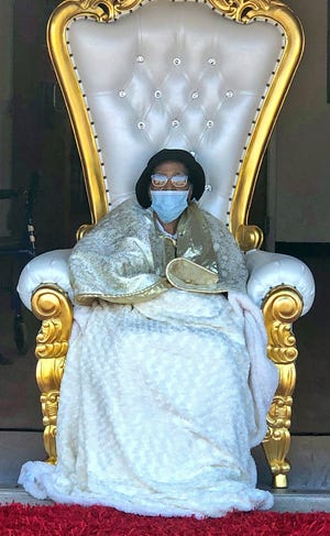 Cora Moore sits on a throne for her 102nd birthday celebration on Sunday.