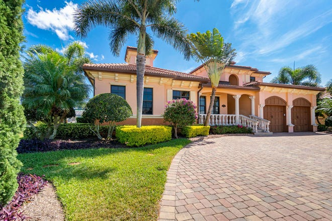 A 4,000-square-foot waterside Spanish estate home with private dock and luxurious outdoor spaces is on the market for $1,345,000 in the community of Punta Gorda Isles. (Corey Barker / Skyscape Pix)