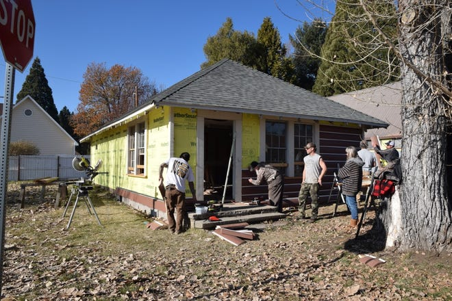 Volunteers work on the old McCloud Courthouse.