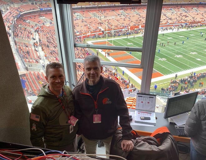 Uniontown resident Jeff Shreve (right) is the public announcer for the Cleveland Browns.