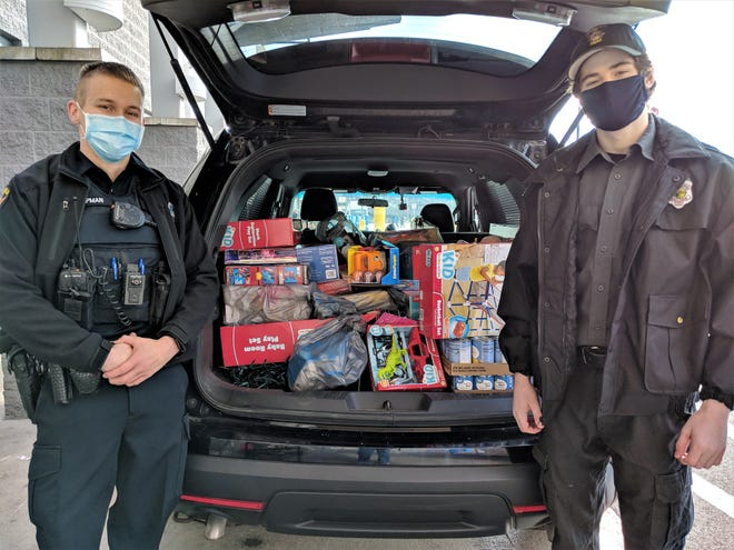 Springfield Police Officer Hunter Chapman and Explorer Patrick Gaffney collect items at Walmart during Fill A Cruiser.