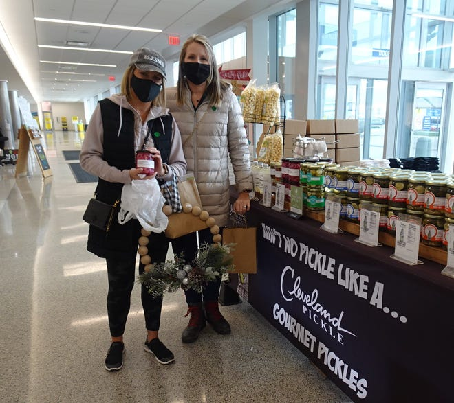 Nicole Taylor and Amy Wahl stopped at the Cleveland Pickle table to buy a jar of pickled onion.